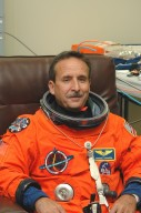 KENNEDY SPACE CENTER, FLA. -- In the Operations and Checkout Building at NASA?s Kennedy Space Center, Return to Flight STS-114 Mission Specialist Charles Camarda checks the fit of his launch and entry suit. This is Camarda?s first Shuttle launch. There are two days to the launch of Space Shuttle Discovery scheduled for 3:51 p.m. July 13. This launch is the 114th Space Shuttle flight and is scheduled to last about 12 days with a planned KSC landing at about 11:06 a.m. EDT on July 25.