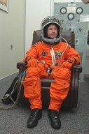 KENNEDY SPACE CENTER, FLA. -- In the Operations and Checkout Building at NASA?s Kennedy Space Center, Return to Flight STS-114 Mission Specialist Stephen Robinson checks the fit of his launch and entry suit and helmet. This is Robinson?s third Shuttle launch. There are two days to the launch of Space Shuttle Discovery scheduled for 3:51 p.m. July 13. This launch is the 114th Space Shuttle flight and is scheduled to last about 12 days with a planned KSC landing at about 11:06 a.m. EDT on July 25.