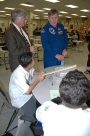 KENNEDY SPACE CENTER, FLA. - Center Director Jim Kennedy (left) and astronaut Roger Crouch talk to students at South Plantation High School in Plantation, Fla. Kennedy and Crouch are visiting the NASA Explorer School (NES) to share the vision for space exploration with the next generation. During the visit, Crouch is talking with students about our destiny as explorers, NASA's stepping stone approach to exploring Earth, the moon, Mars and beyond, how space impacts our lives, and how people and machines rely on each other in space. The Agency's NES program establishes a three-year partnership annually between NASA and 50 NASA Explorer School teams, consisting of teachers and education administrators from diverse communities nationwide. Photo credit: NASA/Cory Huston