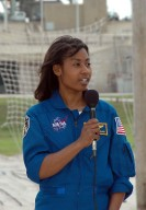 KENNEDY SPACE CENTER, FLA. - During a pause in their prelaunch activities at the pad, the STS-121 crew talk to the media. They are standing in the landing area of the slidewire baskets. With the microphone is Mission Specialist Stephanie Wilson. The crew is at Kennedy for Terminal Countdown Demonstration Test activities. Over several days, the crew will practice emergency egress from the pad and suit up in their orange flight suits for the simulated countdown to launch. Space Shuttle Discovery is designated to launch July 1 on mission STS-121. It will carry supplies to the International Space Station. Photo credit: NASA/Kim Shiflett