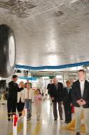 KENNEDY SPACE CENTER, FLA. - In the Orbiter Processing Facility,Scott Thurston (far left), Crew Exploration Vehicle manager in the Shuttle Processing Directorate, gives a personal tour to U.S. Vice President Dick Cheney (center) and his family. They are walking underneath the orbiter Atlantis. Thurston previously was the NASA flow director for Atlantis. Walking next to Cheney is Shana Dale, NASA deputy administrator. Cheney flew in to view the launch of Space Shuttle Discovery on mission STS-121. Photo credit: NASA/Kim Shiflett