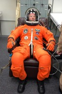 KENNEDY SPACE CENTER, FLA. - The STS-121 crew are donning their orange launch and entry suits for launch today on Space Shuttle Discovery. Here, Mission Specialist Thomas Reiter, who represents the European Space Agency, is ready to go. Reiter is making his first space shuttle flight. The launch is the 115th shuttle flight and the 18th U.S. flight to the International Space Station. During the 12-day mission, the STS-121 crew will test new equipment and procedures to improve shuttle safety, as well as deliver supplies and make repairs to the International Space Station. Photo credit: NASA/Kim Shiflett