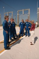 KENNEDY SPACE CENTER, FLA. - The STS-115 crew gets instructions on landing the slidewire baskets, used during emergency egress from the launch pad. From left are Mission Specialists Joseph Tanner and Heidemarie Stefanyshyn-Piper, Commander Brent Jett, and Mission Specialists Daniel Burbank, Chris Ferguson and Steven MacLean, who is with the Canadian Space Agency. The mission crew is at KSC for Terminal Countdown Demonstration Test (TCDT) activities that are preparation for launch on Space Shuttle Atlantis, scheduled to take place in a window that opens Aug. 27. During their 11-day mission to the International Space Station, the STS-115 crew will continue construction of the station and attach the payload elements, the Port 3/4 truss segment with its two large solar arrays. Photo credit: NASA/Cory Huston