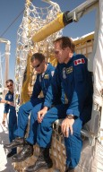 KENNEDY SPACE CENTER, FLA. - The STS-115 crew practices exiting from the slidewire basket, used during emergency egress from the launch pad. Sitting in the basket are Pilot Chris Ferguson and Mission Specialist Steven MacLean, who is with the Canadian Space Agency. On the left is Mission Specialist Daniel Burbank. The mission crew is at KSC for Terminal Countdown Demonstration Test (TCDT) activities that are preparation for launch on Space Shuttle Atlantis, scheduled to take place in a window that opens Aug. 27. During their 11-day mission to the International Space Station, the STS-115 crew will continue construction of the station and attach the payload elements, the Port 3/4 truss segment with its two large solar arrays. Photo credit: NASA/Cory Huston