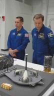 KENNEDY SPACE CENTER, FLA. - In the Orbiter Processing Facility, members of the STS-116 crew look over flight hardware during the Crew Equipment Interface Test. Seen here are Pilot William Oefelein (left) and Mission Specialist Christer Fugelsang, who represents the European Space Agency. Mission crews make frequent trips to the Kennedy Space Center to become familiar with the equipment and payloads they will be using. STS-116 will be mission No. 20 to the International Space Station and construction flight 12A.1. The mission payload is the SPACEHAB module, the P5 integrated truss structure and other key components. Launch is scheduled for no earlier than Dec. 7. Photo credit: NASA/Kim Shiflett