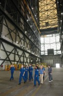KENNEDY SPACE CENTER, FLA. - Striding through the Vehicle Assembly Building are STS-116 crew members (from left) Mark Polansky, commander; Nicholas Patrick, Sunita Williams, Christer Fugelsang and Joan Higginbotham, mission specialists. The crew is at KSC for a Crew Equipment Interface Test. Mission crews make frequent trips to the Kennedy Space Center to become familiar with the equipment and payloads they will be using. STS-116 will be mission No. 20 to the International Space Station and construction flight 12A.1. The mission payload is the SPACEHAB module, the P5 integrated truss structure and other key components. Launch is scheduled for no earlier than Dec. 7. Photo credit: NASA/Kim Shiflett