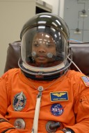KENNEDY SPACE CENTER, FLA. -- The crew members of mission STS-116 are suiting up for launch at 9:35 p.m. EST from Launch Pad 39B aboard Space Shuttle Discovery. Pictured here is Mission Specialist Robert Curbeam, after donning his helmet. Curbeam will be making his third shuttle flight. This is Discovery's 33rd mission and the first night launch since 2003. The 20th shuttle mission to the International Space Station, STS-116 carries another truss segment, P5. It will serve as a spacer, mated to the P4 truss that was attached in September. After installing the P5, the crew will reconfigure and redistribute the power generated by two pairs of U.S. solar arrays. Landing is expected Dec. 19 at KSC. Photo credit: NASA/Kim Shiflett