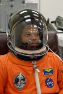 KENNEDY SPACE CENTER, FLA. -- The crew members of mission STS-116 are suiting up for a second launch attempt at 8:47 p.m. EST from Launch Pad 39B aboard Space Shuttle Discovery. Pictured here is Mission Specialist Robert Curbeam, after donning his helmet. Curbeam will be making his third shuttle flight. The first launch attempt of STS-116 on Dec. 7 was postponed due a low cloud ceiling over Kennedy Space Center. This is Discovery's 33rd mission and the first night launch since 2002. The 20th shuttle mission to the International Space Station, STS-116 carries another truss segment, P5. It will serve as a spacer, mated to the P4 truss that was attached in September. After installing the P5, the crew will reconfigure and redistribute the power generated by two pairs of U.S. solar arrays. Landing is expected Dec. 19 at KSC. Photo credit: NASA/Kim Shiflett