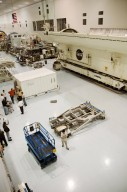"""KENNEDY SPACE CENTER, FLA. -- Seen on the floor of the Space Station Processing Facility are (center left) the container with the Japanese Experiment Module (JEM) remote manipulator system and (lower right) the ground support equipment that will be used to lift it. The Japanese Aerospace Exploration Agency developed the laboratory known as """"Kibo"""" (Hope) and includes an exposed facility (platform) for space environment experiments, the RMS and two logistics modules. Japan's primary contribution to the International Space Station, it will enhance the unique research capabilities of the orbiting complex by providing an additional environment for astronauts to conduct science experiments. The various JEM components will be assembled in space over the course of three Shuttle missions. The JEM and RMS are scheduled to launch on mission STS-124 no earlier than February 2008. Photo credit: NASA/Dimitri Gerondidakis"""