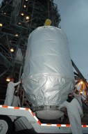 KENNEDY SPACE CENTER, FLA. -- On Launch Pad 17-B at Cape Canaveral Air Force Station, technicians stand by as the THEMIS spacecraft is lifted off its transporter. The spacecraft will be lifted into the mobile service tower and, after encapsulation, mated with the third stage of the Delta II rocket. THEMIS consists of five identical probes, the largest number of scientific satellites ever launched into orbit aboard a single rocket. The THEMIS mission is to investigate what causes auroras in the Earth's atmosphere to dramatically change from slowly shimmering waves of light to wildly shifting streaks of color. Discovering what causes auroras to change will provide scientists with important details on how the planet's magnetosphere works and the important Sun-Earth connection. THEMIS is scheduled to launch aboard a Delta II rocket on Feb. 15 during a window extending from 6:08 to 6:27 p.m. Photo credit: NASA/Amanda Diller