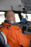 KENNEDY SPACE CENTER, FLA. -- STS-117 Commander Frederick Sturckow settles into his seat in the shuttle training aircraft, or STA, at KSC's Shuttle Landing Facility. He will be making practice landings in the STA, which is a Grumman American Aviation-built Gulf Stream II jet that was modified to simulate an orbiter's cockpit, motion and visual cues, and handling qualities. In flight, the STA duplicates the orbiter's atmospheric descent trajectory from approximately 35,000 feet altitude to landing on a runway. STS-117 is scheduled to launch at 7:38 p.m. June 8. During the 11-day mission and three spacewalks, the crew will work with flight controllers at NASA's Johnson Space Center in Houston to install the 17-ton segment on the station's girder-like truss and deploy the set of solar arrays, S3/S4. The mission will increase the space station's power capability in preparation for the arrival of new science modules from the European and Japanese space agencies. Photo credit: NASA/Kim Shiflett