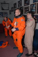 KENNEDY SPACE CENTER, Fla. -- STS-118 Commander Scott Kelly, left, and Pilot Charlie Hobaugh check the fit of their launch and entry suits. The fitting is part of the Terminal Countdown Demonstration Test, or TCDT, activities that include a simulated launch countdown. Kelly and Hobaugh are suiting up also for landing practice in the shuttle training aircraft, known as an STA. The STA is a Grumman American Aviation-built Gulf Stream II jet that was modified to simulate an orbiter's cockpit, motion and visual cues, and handling qualities. In flight, the STA duplicates the orbiter's atmospheric descent trajectory from approximately 35,000 feet altitude to landing on a runway. The STS-118 mission is the 22nd flight to the International Space Station and is targeted for launch on Aug. 7. The mission payload aboard Space Shuttle Endeavour includes the S5 truss, a SPACEHAB module and external stowage platform 3. NASA/George Shelton