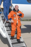 KENNEDY SPACE CENTER, FLA. - STS-118 Commander Scott Kelly is satisfied with his training session in the shuttle training aircraft, or STA, at the Shuttle Landing Facility, Kennedy Space Center's airstrip. He and STS-118 Pilot Charlie Hobaugh were at the facility to practice landings for their upcoming mission. The STA is a Grumman American Aviation-built Gulf Stream II jet that was modified to simulate an orbiter's cockpit, motion and visual cues, and handling qualities. In flight, the STA duplicates the orbiter's atmospheric descent trajectory from approximately 35,000 feet altitude to landing on a runway. Endeavour's STS-118 mission is the 22nd shuttle flight to the International Space Station. It will continue space station construction by delivering a third starboard truss segment, S5. Other payloads include the SPACEHAB module, making its last voyage, and the external stowage platform 3 with a control moment gyroscope on it. The flight will include at least three spacewalks. The crew will also debut a new system that enables docked shuttles to draw electrical power from the station to extend visits to the outpost. Launch is set for Aug. 8 at 6:36 p.m. EDT. NASA/Kim Shiflett
