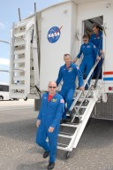 KENNEDY SPACE CENTER, FLA. -- After landing aboard Endeavour to complete mission STS-118, the crew exits the crew transport vehicle. Leading the way is Commander Scott Kelly. Behind him are Pilot Charlie Hobaugh and Mission Specialists Tracy Caldwell and Rick Mastracchio. On the mission, the crew installed a new gyroscope, an external spare parts platform and another truss segment to the expanding station. Endeavour's main gear touched down at 12:32:16 p.m. EDT. Nose gear touchdown was at 12:32:29 p.m. and wheel stop was at 12:33:20 p.m. Endeavour landed on orbit 201. STS-118 was the 119th space shuttle flight, the 22nd flight to the station, the 20th flight for Endeavour and the second of four missions planned for 2007. This was the 65th landing of an orbiter at Kennedy. Photo credit: NASA/Kim Shiflett