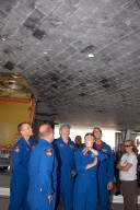 KENNEDY SPACE CENTER, FLA. -- Members of the STS-118 crew take a close look at the damaged tile on the underside of Endeavour. From left are Pilot Charlie Hobaugh, Commander Scott Kelly and Mission Specialists Dave Williams, Tracy Caldwell and Rick Mastracchio. On the mission, the crew installed a new gyroscope, an external spare parts platform and another truss segment to the expanding station. Endeavour's main gear touched down at 12:32:16 p.m. EDT. Nose gear touchdown was at 12:32:29 p.m. and wheel stop was at 12:33:20 p.m. Endeavour landed on orbit 201. STS-118 was the 119th space shuttle flight, the 22nd flight to the station, the 20th flight for Endeavour and the second of four missions planned for 2007. This was the 65th landing of an orbiter at Kennedy. Photo credit: NASA/Kim Shiflett