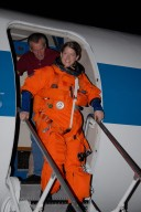 KENNEDY SPACE CENTER, FLA. -- STS-120 Commander Pamela Melroy disembarks from the shuttle training aircraft, or STA, after successful landing practice on NASA's Shuttle Landing Facility runway. A modified Grumman American Aviation-built Gulf Stream II jet, the STA simulates an orbiter's cockpit, motion and visual cues and handling qualities. In flight, the STA duplicates the orbiter's atmospheric descent trajectory from approximately 35,000 feet altitude to landing on a runway. Melroy and other crew members are at Kennedy Space Center to take part in the terminal countdown demonstration test, which also includes a simulated launch countdown. Mission STS-120 is targeted for Oct. 23. Photo credit: NASA/Kim Shiflett