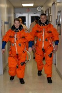 KENNEDY SPACE CENTER, FLA. -- STS-120 Commander Pamela Melroy and Pilot George Zamka are suited in their orange launch and entry suits and on their way to NASA's Shuttle Landing Facility to practice landing in the shuttle training aircraft, or STA. A modified Grumman American Aviation-built Gulf Stream II jet, the STA simulates an orbiter's cockpit, motion and visual cues and handling qualities. In flight, the STA duplicates the orbiter's atmospheric descent trajectory from approximately 35,000 feet altitude to landing on a runway. Melroy and other crew members are at Kennedy Space Center to take part in the terminal countdown demonstration test, which also includes a simulated launch countdown. Mission STS-120 is targeted for Oct. 23. Photo credit: NASA/Kim Shiflett