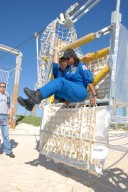 KENNEDY SPACE CENTER, FLA. -- During emergency egress training as part of the pre-launch terminal countdown demonstration test, or TCDT, STS-120 crew members practice getting out of the slidewire basket at the landing site. Jumping out is Mission Specialist Stephanie Wilson. Waiting his turn behind her is Mission Specialist Doug Wheelock. The TCDT provides astronauts and ground crews an opportunity to participate in various simulated countdown activities, including equipment familiarization and emergency training. The STS-120 mission will deliver the U.S. Node 2 module, named Harmony, aboard space shuttle Discovery to the International Space Station. Launch of Discovery on mission STS-120 is targeted for Oct. 23 at 11:38 a.m. EDT on a 14-day mission. Photo credit: NASA/Kim Shiflett