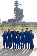 KENNEDY SPACE CENTER, FLA. -- The STS-120 crew takes a moment for a group photo at the slidewire basket landing on Launch Pad 39A after taking part in a press conference. From left are Commander Pamela Melroy, Pilot George Zamka and Mission Specialists Scott Parazynski, Stephanie Wilson, Doug Wheelock, Paolo Nespoli and Daniel Tani. Nespoli represents the European Space Agency. The crew is at NASA's Kennedy Space Center to take part in terminal countdown demonstration test activities that include emergency egress procedures and a simulated launch countdown. Mission STS-120, which will carry the Italian-built U.S. Node 2 to the International Space Station, is targeted for launch on Oct. 23. Tani will remain aboard the station and return with the STS-122 crew, targeted to launch Dec. 6. Photo credit: NASA/Kim Shiflett