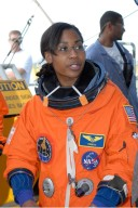 KENNEDY SPACE CENTER, FLA. -- STS-120 Mission Specialist Stephanie Wilson relaxes after practicing emergency egress, part of the prelaunch terminal countdown demonstration test, or TCDT. Her name patch reflects the nicknames the crew gave each other for the event. The TCDT at NASA's Kennedy Space Center provides astronauts and ground crews an opportunity to participate in various launch preparation activities, including equipment familiarization and emergency training. The STS-120 mission will deliver the U.S. Node 2 module, named Harmony, aboard space shuttle Discovery to the International Space Station. Discovery is targeted to launch on its 14-day mission at 11:38 a.m. EDT on Oct. 23. Photo credit: NASA/Kim Shiflett