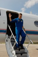 KENNEDY SPACE CENTER, FLA. -- STS-120 Mission Specialist Scott Parazynski acknowledges the welcome of nearby spectators as he exits the Shuttle Training Aircraft after arrival at NASA's Kennedy Space Center. Parazynski will be making his fifth shuttle flight on the mission. The crew has returned to Kennedy to prepare for launch aboard space shuttle Discovery at 11:38 a.m. EDT on Oct. 23. The mission will be the 23rd shuttle flight to the International Space Station, delivering the Italian-built U.S. Node 2, called Harmony. The 14-day mission includes five spacewalks -- four by shuttle crew members and one by the station?s Expedition 16 crew -- to install Harmony and move the P6 solar arrays to their permanent position and deploy them. Discovery is expected to complete its mission and return home at 4:47 a.m. EST on Nov. 6. Photo credit: NASA/Kim Shiflett