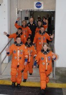 KENNEDY SPACE CENTER, FLA. -- The STS-120 crew strides out of the Operations and Checkout Building at NASA's Kennedy Space Center after suiting up for launch aboard space shuttle Discovery to the International Space Station. Leading the way, on the right, is Commander Pamela Melroy, followed by Mission Specialists Doug LWheelock and Paolo Nespoli, who represents the European Space Agency. On the left is Pilot George Zamka, followed by Mission Specialists Stephanie Wilson, Daniel Tani and Scott Parazynski. Tani will remain on the International Space Station to join the Expedition 16 crew after the mission is complete. The crew is heading for the Astrovan that will take them to Launch Pad 39A. Discovery is scheduled for liftoff at 11:38 a.m. EDT. The mission will be the 23rd assembly flight to the space station and the 34th flight for Discovery. Payload on the mission is the Italian-built U.S. Node 2, called Harmony. During the 14-day mission, the crew will install Harmony and move the P6 solar arrays to their permanent position and deploy them. Discovery is expected to complete its mission and return home at 4:47 a.m. EST on Nov. 6. Photo credit: NASA/Kim Shiflett