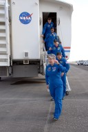 KENNEDY SPACE CENTER, FLA. -- At NASA's Kennedy Space Center, the STS-120 crew exits the crew transport vehicle after their successful landing aboard space shuttle Discovery. Leading the way is Commander Pamela Melroy, followed by Pilot George Zamka and mission specialists Scott Parazynski, Stephanie Wilson and Doug Wheelock. Discovery completed the 15-day mission STS-120, with an on-time landing at 1:01:16 p.m. Wheel stop was at 1:02:07 p.m. Mission elapsed time was 15 days, 2 hours, 24 minutes and 2 seconds. Mission STS-120 continued the construction of the station with the installation of the Harmony Node 2 module and the relocation of the P6 truss. Photo credit: NASA//Kim Shiflett