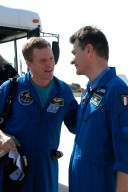 KENNEDY SPACE CENTER, FLA. -- STS-120 Mission Specialists Scott Parazynski (left) and Paolo Nespoli talk before their return to flight to Houston. A welcoming ceremony for the crew is planned at NASA's Hangar 276 on the south end of Ellington Field in Texas. On the 15-day mission, the STS-120 crew continued the construction of the station with the installation of the Harmony Node 2 module and the relocation of the P6 truss. They landed Nov. 7 at NASA's Kennedy Space Center . Photo credit: NASA/George Shelton