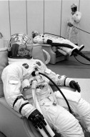 KENNEDY SPACE CENTER, FLA. -- Apollo 7 astronauts Donn F. Eisele, foreground, and Walter Cunningham, rear, undergo spacesuit checks today prior to their Earth orbital mission with Walter M. Schirra Jr., not shown. The three space pilots lifted off atop a Saturn 1B space vehicle from Cape Kennedy's Launch Complex 34 at 11:03 a.m. EDT, Oct. 11, 1968. The National Aeronautics and Space Administration's first manned Apollo flight is designed to verify spacecraft systems for future lunar voyages.