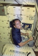 STS-1 ONBOARD PHOTOGRAPHY - STS-1-7-0502: STS-1 Pilot Robert Crippen at lunch.