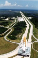 KENNEDY SPACE CENTER, FLA. -- Atlantis, with its new external tank/solid rocket booster stack, rolls out to Pad 39A on August 20, 1996, in preparation for launch of STS-79 on the fourth Mir docking mission. Atlantis will return Astronaut Shannon Lucid to Earth after her record-breaking stay by an American on the Russian space station. Lucid has completed 21 weeks in space this week. Astronaut John Blaha will trade places with Lucid for a planned four-month stay aboard Mir. Atlantis will also carry the first SPACEHAB Double Module