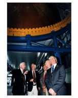 """KENNEDY SPACE CENTER, FLA. -- Some of the former Apollo program astronauts tour the new Apollo/Saturn V Center (ASVC) at KSC prior to the gala grand opening ceremony for the facility that was held Jan. 8, 1997. The astronauts were invited to participate in the event, which also featured NASA Administrator Dan Goldin and KSC Director Jay Honeycutt. Passing underneath the KSC Apollo/Saturn V inside the building are (from left): Apollo 10 Lunar Module Pilot and Apollo 17 Commander Eugene A. Cernan; Apollo 9 Lunar Module Pilot Russell L. Schweikart; Apollo 10 Command Module Pilot and Apollo 16 Commander John W. Young; Apollo 10 Commander Thomas P. Stafford; and Apollo 11 Lunar Module Pilot Edwin E. """"Buzz"""" Aldrin, Jr. The ASVC also features several other Apollo program spacecraft components, multimedia presentations and a simulated Apollo/Saturn V liftoff. The facility will be a part of the KSC bus tour that embarks from the KSC Visitor Center"""