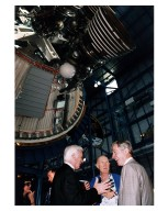 KENNEDY SPACE CENTER, FLA. -- Some of the former Apollo program astronauts tour the new Apollo/Saturn V Center (ASVC) at KSC prior to the gala grand opening ceremony for the facility that was held Jan. 8, 1997. The astronauts were invited to participate in the event, which also featured NASA Administrator Dan Goldin and KSC Director Jay Honeycutt. Discussing old times beneath the KSC Apollo/Saturn V rocket inside the building are (from left) Apollo 10 Lunar Module Pilot and Apollo 17 Commander Eugene A. Cernan; Apollo 10 Commander Thomas P. Stafford and Apollo 16 Commander John W. Young. The ASVC also features several other Apollo program spacecraft components, multimedia presentations and a simulated Apollo/ Saturn V liftoff. The facility will be a part of the KSC bus tour that embarks from the KSC Visitor Center
