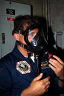 STS-86 Mission Specialist David A. Wolf dons a gas mask as part of training exercises during the Terminal Countdown Demonstration Test (TCDT), a dress rehearsal for launch. Wolf is wearing the patch from his first and only mission to date, STS-58 in 1993. STS-86 will be the seventh docking of the Space Shuttle with the Russian Space Station Mir. During the docking, Wolf will transfer to the orbiting Russian station and become a member of the Mir 24 crew, replacing U.S. astronaut C. Michael Foale, who has been on the Mir since the last docking mission, STS-84, in May. Launch of Mission STS-86 aboard the Space Shuttle Atlantis is targeted for Sept. 25