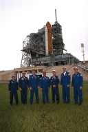 KENNEDY SPACE CENTER, Fla. -- With the Space Shuttle Atlantis behind them, the STS-86 crew poses for a photograph at Launch Pad 39A. The seven crew members are at KSC to participate in Terminal Countdown Demonstration Test (TCDT) activities. From left are Mission Specialists Wendy B. Lawrence, David A. Wolf, Scott E. Parazynski, Vladimir Georgievich Titov of the Russian Space Agency, Jean-Loup J.M. Chretien of the French Space Agency, CNES; Commander James D. Wetherbee; and Pilot Michael J. Bloomfield. STS-86 will be the seventh docking of the Space Shuttle with the Russian Space Station Mir. After docking, Wolf will transfer to the Mir 24 crew, replacing astronaut C. Michael Foale, who arrived there during the last docking mission, STS-84, in May. Launch is targeted for Sept. 25