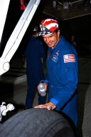 STS-86 Pilot Michael J. Bloomfield, the only space rookie on the crew, feels the heat from a tire on the orbiter Atlantis more than an hour after the landing on KSC?s Runway 15. The nearly 11-day mission ended with main gear touchdown at 5:55:09 p.m. EDT, Oct. 6, 1997. STS-86 was the seventh docking of the Space Shuttle with the Russian Space Station Mir