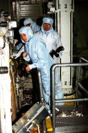 Participating in the Crew Equipment Integration Test (CEIT) at Kennedy Space Center are STS-87 crew members, assisted by Glenda Laws, extravehicular activity (EVA) coordinator, Johnson Space Center. Standing behind Laws are Takao Doi, Ph.D., of the National Space Development Agency of Japan, and Winston Scott, both mission specialists on STS-87. The STS-87 mission will be the fourth United States Microgravity Payload and flight of the Spartan-201 deployable satellite. During the mission, scheduled for a Nov. 19 liftoff from KSC, Dr. Doi and Scott will both perform spacewalks