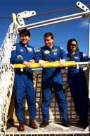 The crew of the STS-87 mission, scheduled for launch Nov. 19 aboard the Space Shuttle Columbia from pad 39B at Kennedy Space Center (KSC), participates in the Terminal Countdown Demonstration Test (TCDT) at KSC. Testing a slidewire basket that is part of the pad?s emergency egress system are, from left, Mission Specialist Takao Doi, Ph.D., of the National Space Development Agency of Japan; Payload Specialist Leonid Kadenyuk of the National Space Agency of Ukraine (NSAU); and Mission Specialist Kalpana Chawla, Ph.D. The TCDT is held at KSC prior to each Space Shuttle flight providing the crew of each mission opportunities to participate in simulated countdown activities. The TCDT ends with a mock launch countdown culminating in a simulated main engine cut-off. The crew also spends time undergoing emergency egress training exercises at the pad and has an opportunity to view and inspect the payloads in the orbiter's payload bay