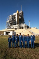The crew of the STS-87 mission, scheduled for launch Nov. 19 aboard the Space Shuttle Columbia from Pad 39B at Kennedy Space Center (KSC), participate in the Terminal Countdown Demonstration Test (TCDT) at KSC. Posing for a group shot by Pad 39B are, from left to right, Mission Specialist Kalpana Chawla, Ph.D.; Mission Specialist Winston Scott; Mission Specialist Takao Doi, Ph.D., of the National Space Development Agency of Japan; Commander Kevin Kregel; Payload Specialist Leonid Kadenyuk of the National Space Agency of Ukraine (NSAU); Pilot Steven Lindsey; and Kadenyuk?s back-up, Yaroslav Pustovyi, Ph.D., also of NSAU. The TCDT is held at KSC prior to each Space Shuttle flight, providing the crew of each mission opportunities to participate in simulated countdown activities. The crew also spends time undergoing emergency egress training exercises at the pad and has an opportunity to view and inspect the payloads in the orbiter's payload bay