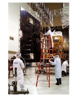 Space Systems/LORAL employees inspect solar panels for the GOES-K weather satellite in the Astrotech facility at Titusville, Fla., as they begin final testing of the imaging system, communications and power systems of the spacecraft. The GOES-K is the third spacecraft to be launched in the new advanced series of geostationary weather satellites for the National Oceanic and Atmospheric Administration (NOAA). The GOES-K is built for NASA and NOAA by Space Systems/LORAL of Palo Alto, Calif. The launch of the satellite from Launch Pad 36B at Cape Canaveral Air Station on an Atlas 1 rocket (AC-79) is currently planned for Apr. 24 at the opening of a launch window which extends from 1:56 to 3:19 a.m. EDT