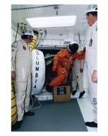 A member of the STS-83 flight crew enters the crew hatch of the Space Shuttle Columbia with the help of the white room crew during Terminal Countdown Demonstration Test (TCDT) exercises for that mission. Members of the white room crew are (from left): Steve Crosbie, Rene Arriens and Bob Saulnier. The STS-83 crew members for the 16-day Microgravity Science Laboratory-1 (MSL-1) mission are: Mission Commander James D. Halsell, Jr.; Pilot Susan L. Still; Payload Commander Janice Voss; Mission Specialists Michael L. Gernhardt and Donald A. Thomas; and Payload Specialists Gregory T. Linteris and Roger K. Crouch