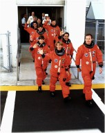 KENNEDY SPACE CENTER, FLA. - Greeted by cheers from wellwishers at KSC and eager for their ventur into space on the Microgrvity Science Laboratory-1 (MSL-1) mission, the STS-83 astronauts depart the Operations and Checkout Building on their way to Launch Pad 39A. Leading the seven-member crew is Mission Commander James D. Halsell Jr. Behind Halsell and to his right is Pilot Susan L. Still. Behind Still is Payload Commander Janice Voss, with Mission Specialist Donald A. Thomas to her left. Behind Thomas, in order, are Mission Specialist Michael L. Gernhardt and Payload Specialists Roger K. Crouch and Gregory T. Linteris. During the scheduled 16-day STS-83 mission, the MSL-1 will be used to test some of the hardware, facilities and procedures that are planned for use on the International Space Station while the flight crew conducts combustion, protein crystal growth and materials processing experiments. Also onboard is the Hitchhiker Cryogenic Flexible Diode (CRYOFD) experiment payload, which is attched to the right side of Columbia's payload bay.