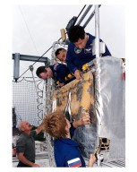STS-84 crew members examine part of the emergency egress system at Launch Pad 39A, during Terminal Countdown Demonstration Test (TCDT) activities. Dressed in their blue flight suits are Mission Specialist Elena V. Kondakova, standing in foreground; and, in basket from right, Mission Specialists Edward Tsang Lu and Carlos I. Noriega and Commander Charles J. Precourt. Ken Clark, a training instructor with United Space Alliance (USA), is standing at lower left. STS-84 will be the sixth docking of the Space Shuttle with the Russian Space Station Mir. After docking, STS-84 Mission Specialist Michael C. Foale will transfer to the space station and become a member of the Mir 23 crew, replacing U.S. astronaut Jerry M. Linenger, who will return to Earth aboard Atlantis. Foale will live and work on Mir until mid-September when his replacement is expected to arrive on the STS-86 mission. STS-84 is targeted for a May 15 liftoff