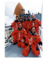 Wearing their orange launch and entry spacesuits, members of the STS-84 crew are all smiles as they pose for a group photograph at Launch Pad 39A with the Space Shuttle Atlantis in the background. Kneeling in front are Mission Specialists Jean-Francois Clervoy, at right, of the European Space Agency, and Carlos I. Noriega. Standing, from left, are Mission Specialist Elena V. Kondakova of the Russian Space Agency, Pilot Eileen Marie Collins, Mission Specialists C. Michael Foale and Edward Tsang Lu, and Commander Charles J. Precourt. STS-84 aboard Atlantis will be the sixth docking of the Space Shuttle with the Russian Space Station Mir. After docking, Foale will transfer to the space station and become a member of the Mir 23 crew, replacing U.S. astronaut Jerry M. Linenger, who will return to Earth aboard Atlantis. Foale will live and work on Mir until mid-September when his replacement is expected to arrive on the STS-86 mission. STS-84 is targeted for a May 15 liftoff