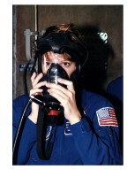 STS-84 Pilot Eileen Marie Collins practices using a gas mask during Terminal Countdown Demonstration Test (TCDT) activities at Launch Pad 39A. STS-84 will be the sixth docking of the Space Shuttle with the Russian Space Station Mir. It will be second space flight for Collins, who was the first woman Shuttle pilot on her initial mission, STS-63 in 1995. After docking, STS-84 Mission Specialist C. Michael Foale will transfer to the space station and become a member of the Mir 23 crew, replacing U.S. astronaut Jerry M. Linenger, who will return to Earth aboard Atlantis. Foale will live and work on Mir until mid-September when his replacement is expected to arrive on the STS-86 mission. STS-84 is targeted for a May 15 liftoff