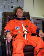 STS-84 Mission Specialist C. Michael Foale laughs during a rare moment of relaxation just a few hours before the scheduled launch. Foale is donning his launch and entry suit in the Operations and Checkout Building. This will be Foale?s fourth space flight. Foale and six other crew members will depart shortly for Launch Pad 39A, where the Space Shuttle Atlantis awaits liftoff on a mission to dock with the Russian Space Station Mir. Foale will transfer to Mir for an approximate fourmonth stay, replacing U.S. astronaut and Mir 23 crew member Jerry M. Linenger, who has been on the Russian space station since Jan. 15. Linenger will return to Earth on Atlantis