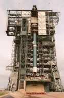 The first stage of Boeing's Delta 7326 rocket, which will be used to launch the Deep Space 1 spacecraft, is lifted into place above the flame trench at Pad 17A at Cape Canaveral Air Station. Targeted for launch on Oct. 15, 1998, this first flight in NASA's New Millennium Program is designed to validate 12 new technologies for scientific space missions of the next century. Onboard experiments include an ion propulsion engine and software that tracks celestial bodies so the spacecraft can make its own navigation decisions without the intervention of ground controllers. Deep Space 1 will complete most of its mission objectives within the first two months but will also do a flyby of a near-Earth asteroid, 1992 KD, in July 1999