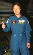 STS-95 Payload Specialist Chiaki Mukai, representing the National Space Development Agency of Japan (NASDA), gives a thumbs up after her arrival aboard a T-38 jet aircraft at the Shuttle Landing Facility at KSC. Mukai and the rest of the crew are at KSC to participate in a Terminal Countdown Demonstration Test (TCDT). The TCDT includes mission familiarization activities, training in emergency exit from the orbiter and launch pad, and a simulated main engine cut-off exercise. The other members on the mission are Mission Commander Curtis L. Brown, Pilot Steven W. Lindsey; Mission Specialists Scott E. Parazynski, Stephen K. Robinson, and Pedro Duque of Spain, representing the European Space Agency (ESA); and Payload Specialist John H. Glenn Jr., senator from Ohio. The STS-95 mission, scheduled for liftoff on Oct. 29, includes research payloads such as the Spartan solar-observing deployable spacecraft, the Hubble Space Telescope Orbital Systems Test Platform, the International Extreme Ultraviolet Hitchhiker, as well as the SPACEHAB single module with experiments on space flight and the aging process