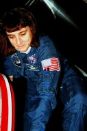 """STS-88 Mission Specialist Nancy J. Currie climbs out of a T-38 jet aircraft in which she arrived after dark at the Shuttle Landing Facility in order to take part in Terminal Countdown Demonstration Test (TCDT) activities. The TCDT provides the crew with simulated countdown exercises, emergency egress training, and opportunities to inspect their mission payloads in the orbiter's payload bay. Mission STS-88 is targeted for launch on Dec. 3, 1998. It is the first U.S. flight for the assembly of the International Space Station and will carry the Unity connecting module. Others in the STS-88 crew are Mission Commander Robert D. Cabana, Pilot Frederick W. """"Rick"""" Sturckow, Mission Specialists Jerry L. Ross, James H. Newman and Sergei Krikalev, a Russian cosmonaut. Ross and Newman will make three spacewalks to connect power, data and utility lines and install exterior equipment"""