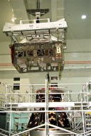 The Photovoltaic Module 1 Integrated Equipment Assembly (IEA) is moved past a Pressurized Mating Adapter in Kennedy Space Center?s Space Station Processing Facility (SSPF) toward the workstand where it will be processed for flight on STS-97, scheduled for launch in April 1999. The IEA is one of four integral units designed to generate, distribute, and store power for the International Space Station. It will carry solar arrays, power storage batteries, power control units, and a thermal control system. The 16-foot-long, 16,850-pound unit is now undergoing preflight preparations in the SSPF